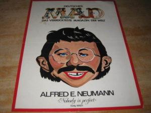 Mad Werbeposter mit Alfred E.Neumann Gesicht